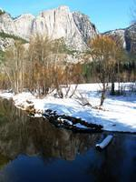 Yosemite point reflected in River Merced